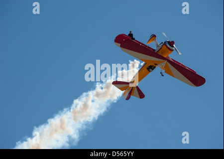 Wing walker, Jane Wicker, sits atop the wing of an upside down biplane at the Thunder in the Valley Air Show in - Stock Photo