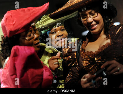 Women wearing the traditional dress of Herero people attend a fashion show in Berlin, Germany, 10 November 2010. - Stock Photo