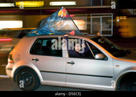 Fans of the town's own Sebastian Vettel drive around waving flags in Heppenheim, Germany, 14 November 2010. The - Stock Photo