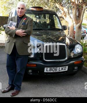 Mitch Winehouse poses in front of a cab in London with his first album, Great Britain, 04 November 2010. The father - Stock Photo