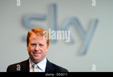 Chairman of the pay-TV broadcaster sky Germany Brian Sullivan is pictured next to the logo of the firm at the head - Stock Photo