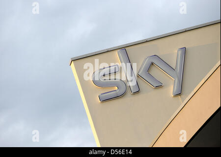 The logo of the pay-TV broadcaster sky Germany is pictured at the head office in Unterfoering near Munich, Germany, - Stock Photo
