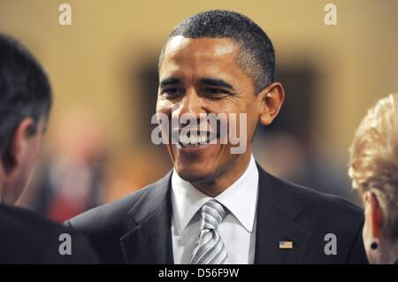 US president Barack Obama talks before another session at the NATO summit conference in Lisbon, Portugal, 20 November - Stock Photo