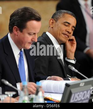 US President Barack Obama and Britain's Prime Minister David Cameron attend the session on Russia during the NATO summit conference at Lisbon, Portugal, 20 November 2010. Photo: RAINERJENSEN Stock Photo