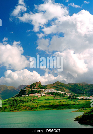 A view of the village of Sierra de la Zahara with the  man-made reservoir (embalse in Spanish) in the foreground - Stock Photo