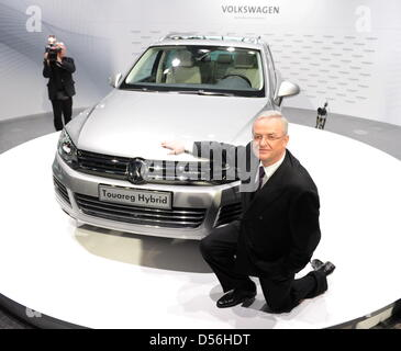 Martin Winterkorn, CEO of Volkswagen AG, poses next to a VW Touareg Hybrid at the annual Volkswagen press conference - Stock Photo