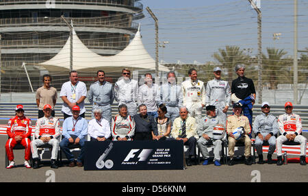 All former Formula One world champions pose for a group photo back row (L-R): Alain Prost, Alan Jones, Nigel Mansell, - Stock Photo