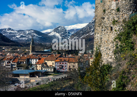Tarascon sur Ariège, , snowy mountains, old fortified tower, with church - Stock Photo