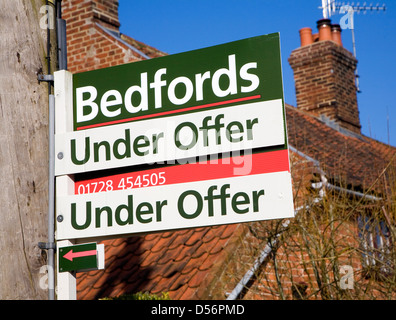 Under Offer property sign for Bedfords estate agent, Wantisden, Suffolk, England - Stock Photo