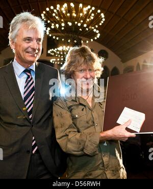 English keyboard player Keith Emerson (R) smiles with his Frankfurt Music Prize 2010 and Frankfurt's head of culture - Stock Photo