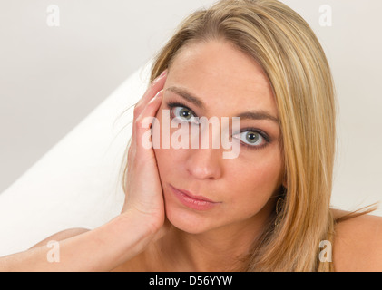 Young woman serious look at camera. - Stock Photo