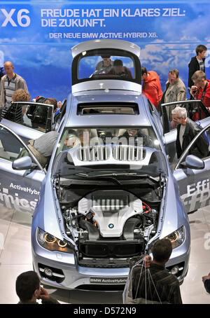 Visitors check out a new BMW X6 ActiveHybrid prototype at the Auto Mobil International (AMI) car show in Leipzig, - Stock Photo