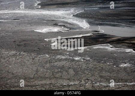 A handout picture made available by the Icelandic coast guard of melt water mixed with rests of lava and ashes that - Stock Photo