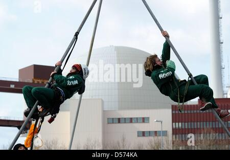 Activists of environmental organisation 'Robin Wood' hang at a scaffolding which blocks the entrance to a nucler - Stock Photo