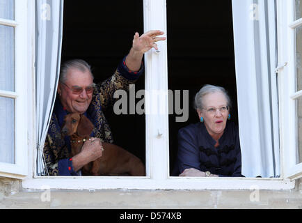 Danish Queen Margrethe and Prince Consort Henrik stand at the window of Fredensborg Palace, Copenhagen, Denmark, - Stock Photo