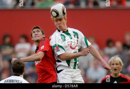 Leverkusen's Stefan Reinartz (L) and Hanover's Mike Hanke vie for the ball during German Bundesliga match Bayer - Stock Photo