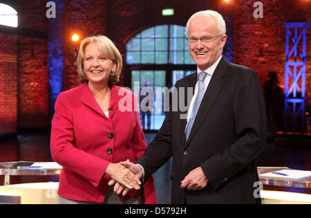 North Rhine Westphalia's minister president Juergen Ruettgers and his challenger Hannelore Kraft greet each other - Stock Photo