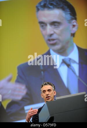 Frank Appel, CEO of Deutsche Post, speaks at the company's general meeting in the Jahrhunderthalle while critical - Stock Photo