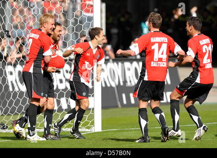 Hanover's Mike Hanke, Sofian Chahed, Steven Cherundolo, Hanno Balitsch and Karim Haggui (L-R) cheer about the goal - Stock Photo