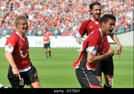 Hanover's Mike Hanke, Christian Schulz and Karim Haggui (L-R) cheer after the goal to the score 1-0 by Haggui during - Stock Photo
