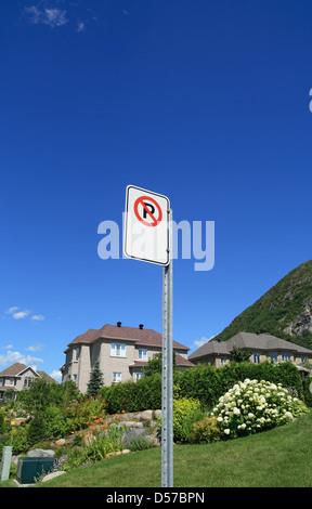 No parking sign in a prestigious suburban neighborhood near mountains. - Stock Photo