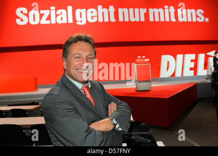 The designated chairman of left wing party 'Die Linke', Klaus Ernst, on the podium at the City Hall in Rostock, - Stock Photo