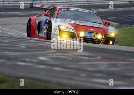 The Audi R8 LMS of Pönix-Racing passes at the 24 Hours on Nurburgring race track in Nuerburg, Germany, 15 May 2010. - Stock Photo