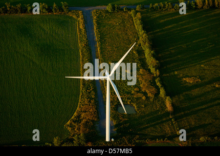 Aerial view of a Siemens Mark 11 wind turbine with access road on Wolfe Island, near Kingston Ontario, Canada.. - Stock Photo