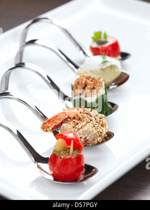 five different appetizers served in a modern style - Stock Photo
