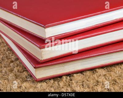 Three stacked books close up - Stock Photo