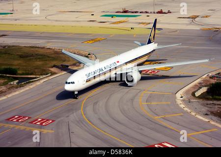 Singapore Airlines Boeing 777-312/ER at Barcelona, El Prat Airport, Spain - Stock Photo