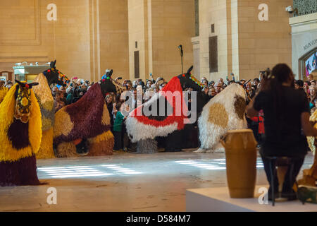 New York, USA. 26th March, 2013. Dancers in 30 colorful horse costumes perform 'Heard-NY' by performance artist - Stock Photo
