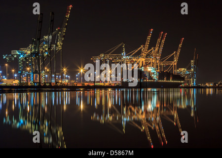 Southampton docks at night with the container ship, Frankfurt Express, being loaded. - Stock Photo