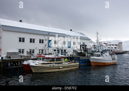 old warehouses and small fishing boats Honningsvag harbour finnmark norway europe - Stock Photo