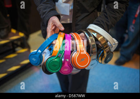 Berlin, Germany. 26th March 2013. 50 Cents and Media Markt present the news 'SMS' headphones collection signs autographs - Stock Photo