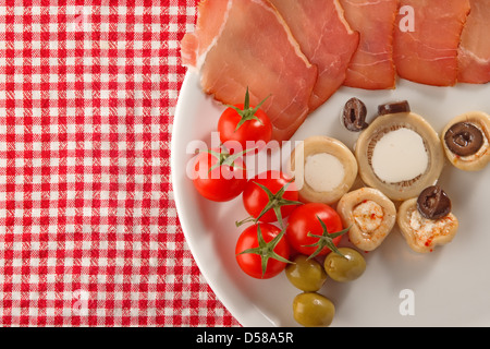 Cold appetizer, plate of assorted cold cuts traditional in mediterranean countries - Stock Photo