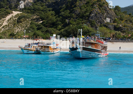 Sightseeing boat moored on the beach of Butterfly Valley, Turkey - Stock Photo