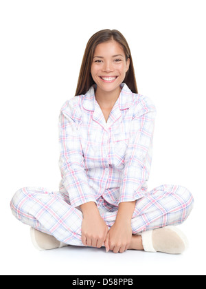 Portrait of happy young Mixed race Asian Chinese / Caucasian woman sitting down in cute pajamas isolated on white - Stock Photo