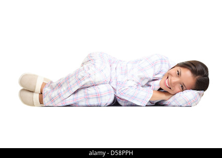 Portrait of happy beautiful mixed race Caucasian / Asian young woman lying isolated on white background - Stock Photo