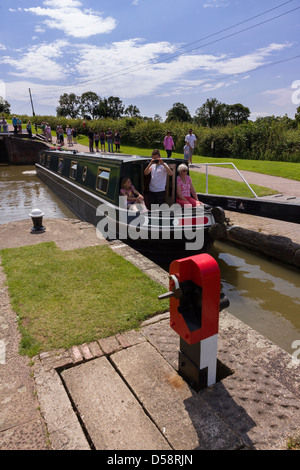 Barge entering lock on a busy day at Foxton Locks, Grand Union Canal, Market Harborough, Leicestershire, England, - Stock Photo