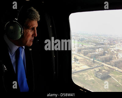 US Secretary of State John Kerry views Kabul from the window of a Black Hawk military helicopter March 26, 2013 - Stock Photo