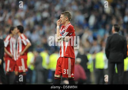 Munich's Bastian Schweinsteiger is dissapointed after the UEFA Champions League final FC Bayern Munich vs FC Internazionale - Stock Photo