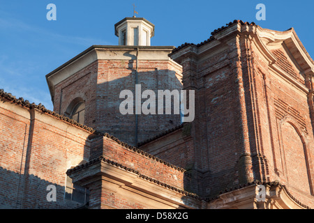 Looking up at the bell tower of Sant Antonio Abate church in the centre of Bereguardo - Stock Photo