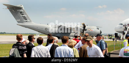 Professtional visitors view a military plane of the type Airbus A400M at the International Aerospace Exhibition - Stock Photo