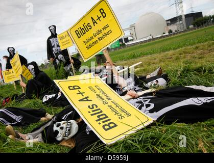 Demonstrators, many of them dressed up as skeltons, lay in front of atomic plant in Biblis, Germany, 12 June 2010. - Stock Photo