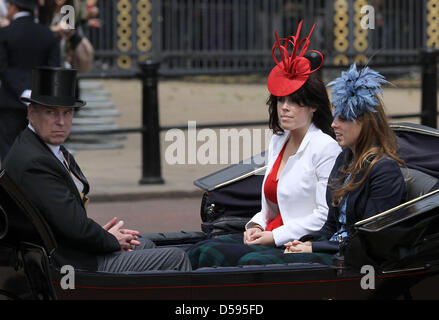Britain's Princess Eugenie (L) and Princess Beatrice leave Buckingham Palace to attend the Trooping the Colour ceremony, - Stock Photo