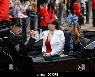 Britain's Princess Eugenie (C) and Princess Beatrice leave Buckingham Palace to attend the Trooping the Colour ceremony, - Stock Photo