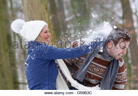young couple take a walk in winter landscape Stock Photo