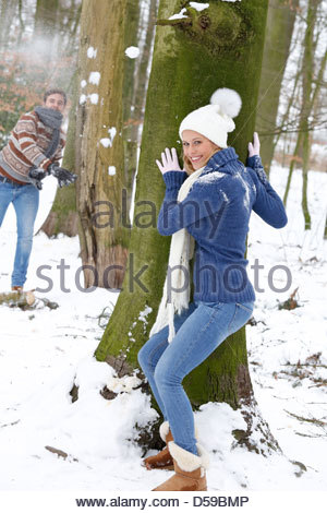 young couple take a walk in winter landscape - Stock Photo