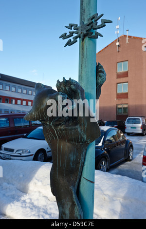 bear sculptures on lampposts outside sor-varanger kommune administration building council offices kirkenes finnmark - Stock Photo